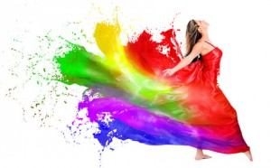 Happy woman dress turning into color paint - isolated over white